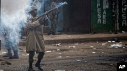 Riot police fire tear gas at protesters during clashes in the Kawangware area of Nairobi, Aug. 10, 2017.