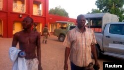 Injured policemen are seen outside Shehu's Palace of Bama, Borno State, Nigeria. May 7, 2013.