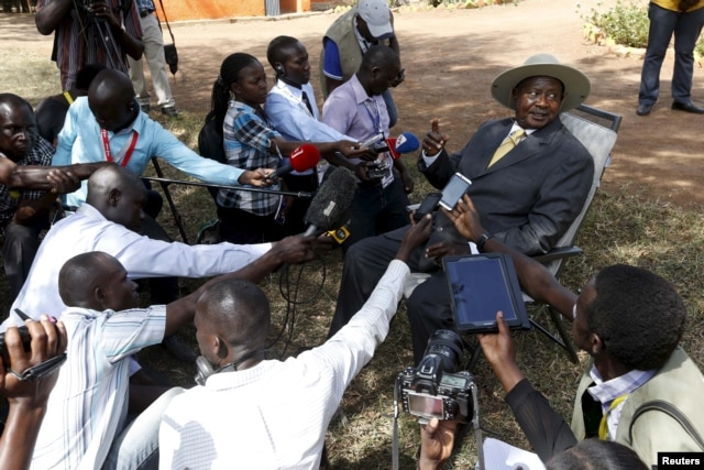 FILE - Uganda's incumbent President Yoweri Museveni speaks to the media soon after casting his vote at a polling station during the presidential elections in Kirihura, in western Uganda, Feb. 18, 2016.