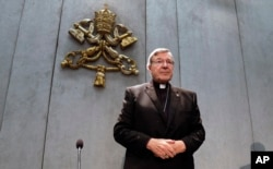 Cardinal George Pell arrives to make a statement, at the Vatican, June 29, 2017.