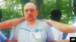 In this photo provided by the Politika newspaper shows war crimes fugitive Goran Hadzic on Mt. Fruska Gora, Serbia, July 20, 2011