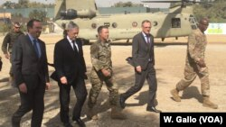 Defense Secretary Jim Mattis, second left, arrives at Resolute Support headquarters in Kabul, Afghanistan, Sept. 7, 2018.