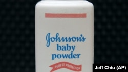 In this April 15, 2011, file photo, a bottle of Johnson's baby powder is displayed. Johnson & Johnson is ending production of its iconic talc-based Johnson's Baby Powder.