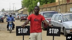 Security in front of the Good News Church in Kaduna, Nigeria, May 3, 2012.