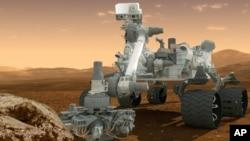 Gambaran kendaraan penjelajah NASA, Curiosity, di permukaan Mars.