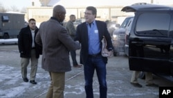 FILE - In this Feb. 20, 2015, file photo, U.S. Secretary of Defense Ash Carter, center, is greeted by Senior Military Assistant U.S. Army Maj. Gen. Ron Lewis as they arrive at Andrews Air Force Base, Md., to travel to Afghanistan.