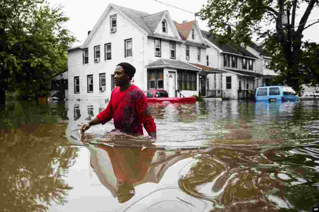 Chris Smith makes his way through floodwaters to the Macedonia Baptist Church in Westville, New Jersey.