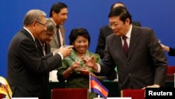 Chinese Finance Minister Lou Jiwei, right, toasts with guests at the signing ceremony of the Asian Infrastructure Investment Bank in Beijing, Oct. 24, 2014. (REUTERS/Takaki Yajima/Pool)
