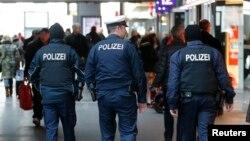 FILE - German police patrol the Hauptbahnhof, Berlin's main train station, Jan. 17, 2015.