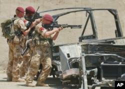 在伊拉克作战的英国陆军。(2003年6月资料照)