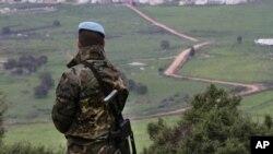 FILE - A Spanish U.N. peacekeeper looks to the U.N-demarcated Blue Line border between Lebanon and Israel, Feb. 24, 2015.