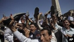 Yemeni anti-government demonstrators shout slogans during a demonstration demanding the resignation of President Ali Abdullah Saleh, in Sanaa, Yemen, February 20, 2011