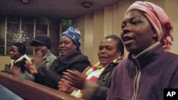 Zimbabwean women at a church in Johannesburg clap, sing and pray for better days