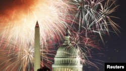 Fireworks light up the sky over the United States Capitol dome and the Washington Monument in Washington July 4, 2011 . (REUTERS/Hyungwon Kang)