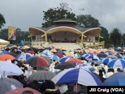Kenyans gather under umbrellas during a Mass by Pope Francis at the University of Nairobi, in Kenya, Nov. 26, 2015. The pope is making his first trip to Africa.