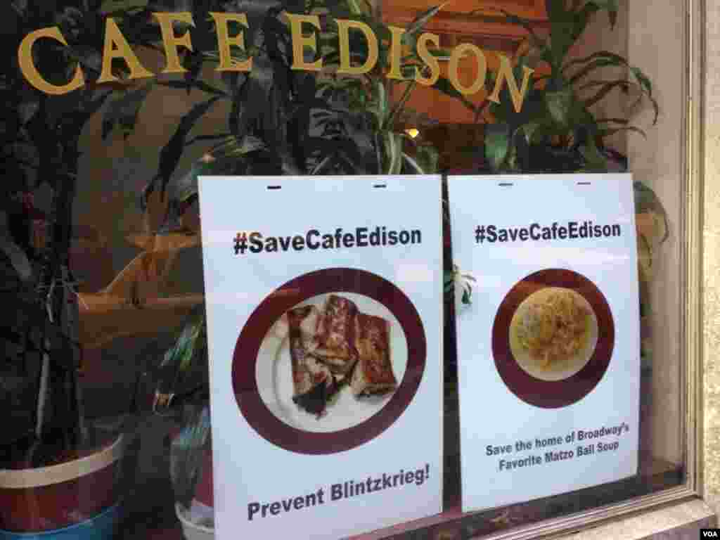 Signs touting the Twitter campaign to save the café are posted in the diner's front window, VOA / Jeff Lunden.