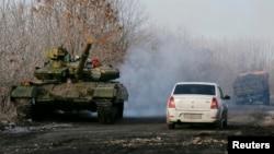 FILE: A pro-Russian separatists tank is seen on a road near the village of Rozsypne, eastern Ukraine, Dec. 15, 2014.