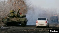 FILE: A pro-Russian separatists tank is seen on a road near the village of Rozsypne, eastern Ukraine, Dec. 15, 2014.