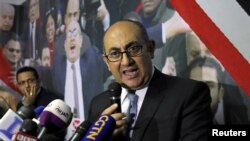FILE - Egyptian lawyer Khaled Ali speaks during a news conference in Cairo, Egypt, Nov. 6, 2017.