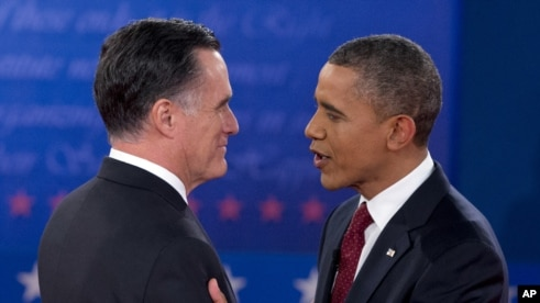 President Barack Obama and Republican presidential candidate Mitt Romney greet each other as they arrive for the presidential debate, October 16, 2012.