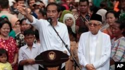 Presiden Joko Widodo didampingi KH Ma'ruf Amin dalam pidato pasca dinyatakan menang dalam Pilpres, di Jakarta Selasa (21/5).