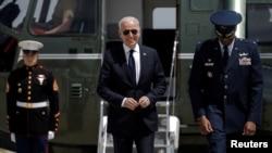 FILE - U.S. President Joe Biden walks from Marine One to board Air Force One as he departs on travel.