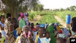 Children and women inside garden at the Wendou Bosseabe refugee camp, Senegal, October 26, 2011.