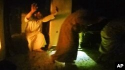 This image made from video taken on Thursday, Oct. 22, 2015 from a helmet camera, shows U.S. and Iraqi special forces freeing hostages from a prison controlled by Islamic State militants.