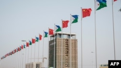 National flags of China and Djibouti fly in front of Djibouti International Free-Trade Zone before the inauguration ceremony in Djibouti, July 5, 2018.