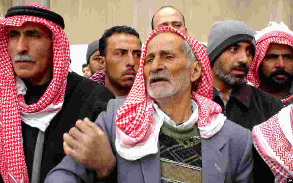 In Damascus, the father (center) of a Syrian general killed in the unrest, Jan. 17, 2012 (E. Arrott/VOA)