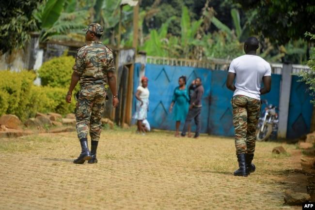 FILE - Soldiers patrol in Bafut, in the northwest English-speaking region of Cameroon, Nov. 15, 2017.