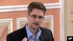 维基解密2013年10月11日发出的一段视频截图:前美国国安局合同工斯诺登在莫斯科的一次会议上发言 (资料照片)
