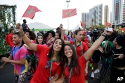 Moroccans Rizlan Kaida Zouak, a judo competitor, left, and Hind Jamili, a canoeist, celebrate at a welcoming ceremony at the 2016 Summer Olympics in Rio de Janeiro, Brazil, Aug. 4, 2016.