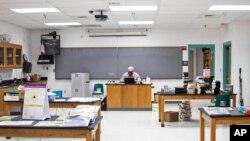 Pinon High School science teacher James Gustafson teaches virtually from his empty classroom in Pinon, Ariz., on Sept. 24, 2020. (Megan Marples/Cronkite News via AP)