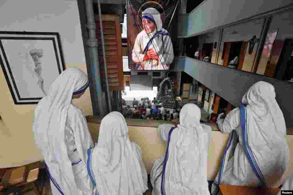 Nuns from the Missionaries of Charity in Kolkata, India, watch a live broadcast of the canonisation of Mother Teresa at a ceremony held in the Vatican, Sept. 4, 2016.