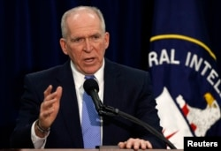 Director of the Central Intelligence Agency (CIA) John Brennan talks to the press during a rare news conference at CIA headquarters in Virginia, Dec. 11, 2014.