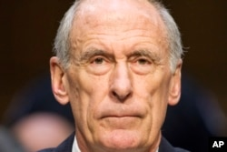 Director of National Intelligence Dan Coats listens while testifying on Capitol Hill in Washington, May 11, 2017, before the Senate intelligence committee.