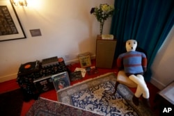 Items in the former bedroom of U.S. musician Jimi Hendrix are seen at the central London flat he used to live in at 23 Brook Street, Feb. 8, 2016.