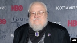 "George RR Martin, photographié en 2014 à la première HBO de la quatrième saison de ""Game of Thrones"" à New York (Evan Agostini/Invision/AP)"