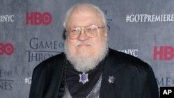 """George RR Martin, photographié en 2014 à la première HBO de la quatrième saison de """"Game of Thrones"""" à New York (Evan Agostini/Invision/AP)"""