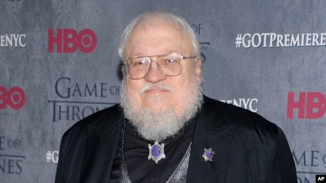 "FILE - George R. R. Martin, pictured in 2014 at HBO's ""Game of Thrones"" fourth-season premiere in New York, writes in his blog that the sixth novel in the series is ""not done. ... I tried, I promise you. I failed.''"