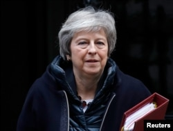 FILE - Britain's Prime Minister Theresa May leaves 10 Downing Street in London, Britain, Nov 21, 2018.