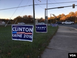 Banners supporting presidential candidates for the US Presidential election 2016 are placed outside one pooling station in Prince William County, Virginia, on Tuesday morning, November 8, 2016. (Poch Reasey/VOA Khmer)