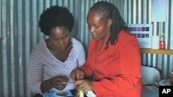 Peer educator Susan Mwangi explains the finer points of reproductive health, Kenya, April 26, 2011.