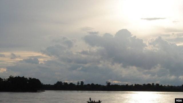 A fishing boat floats on the Mekong river at Sambor in Cambodia's Kratie Provice, a site chosen for a proposed 18-kilometer hydro-dam.