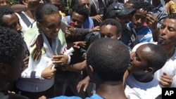 Prominent opposition figure Birtukan Mideksa, middle in green jacket, is being greeted by hundreds of her supporters shortly after her release in Addis Ababa, Ethiopia (2010 File)