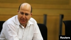 FILE -Moshe Yaalon attends a Likud-Beiteinu party meeting at the Knesset, in Jerusalem, March 14, 2013.