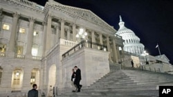 Congressmen walk down the steps of the House of Representatives as they work overnight on a spending bill, on Capitol Hill in Washington (File Photo)