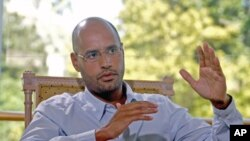 Saif al-Islam, son of Libyan leader Moammar Gadhafi, indicates that Libya plans an enhanced oil recovery round to develop its production capacity during an interview with Reuters, in Nice, France, July 30, 2007 (file photo)