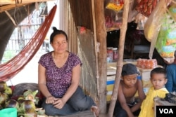 "Neth Samun, 56, who runs a small grocery store in Chantrey commune, says she is afraid to talk about politics anymore. ""Before, we talked about garment factories, garment workers' pay, and our nation's issues, but now we don't dare to talk,"" said Samun. Feb. 14, 2018 (Sun Narin/VOA Khmer)"